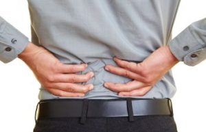 Man Grasping Back in Pain From Chiropractor Atlanta GA